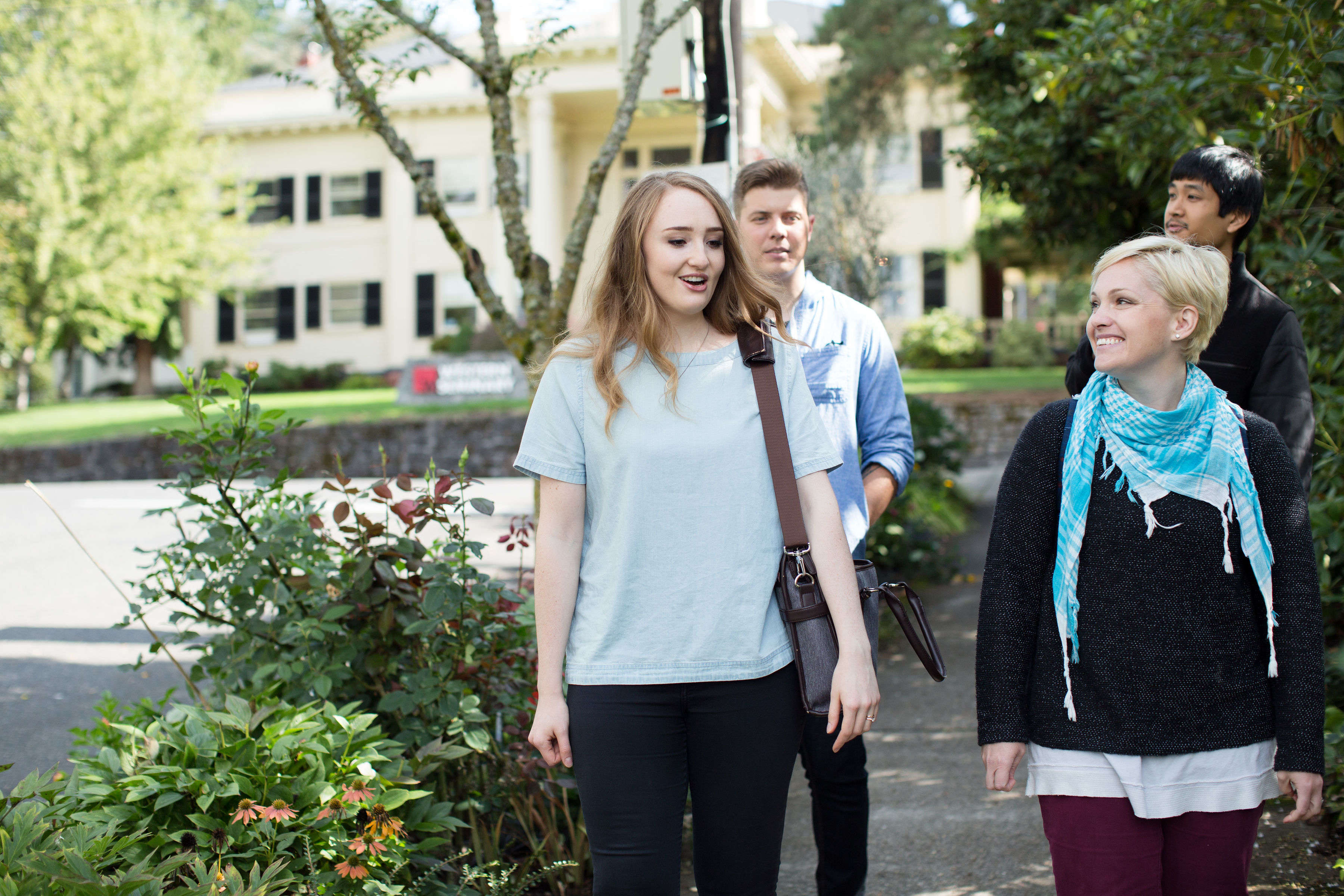 Photograph of staff and students walking and talking